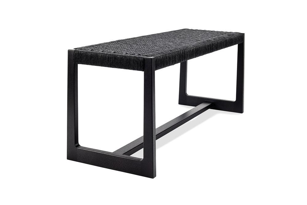 Long and low Matteawan stool in ebonized walnut and black Danish cord