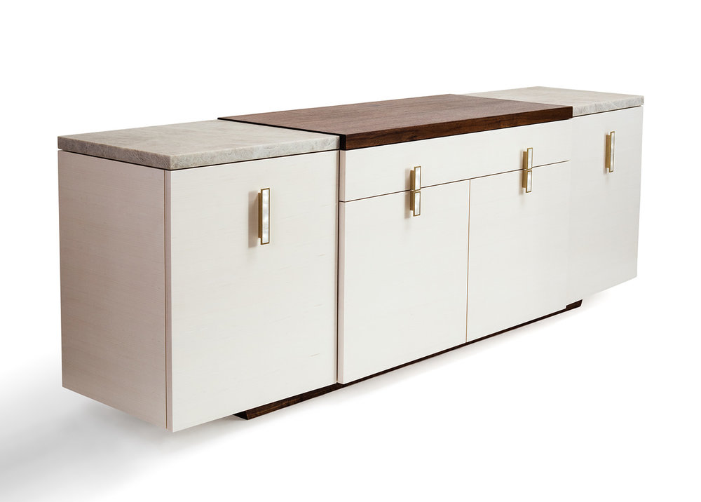 3/4 view of the Park credenza in bleached maple, walnut and quartzite tops, brass and mother of pearl pulls