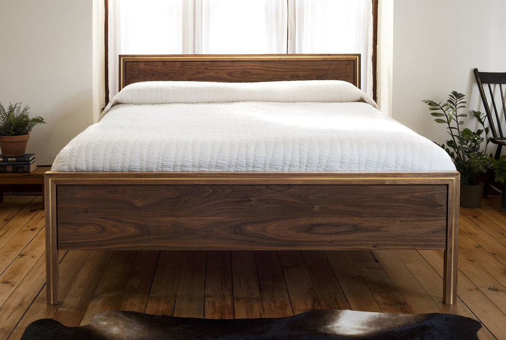 Front view of the Hudson bed in walnut and brass