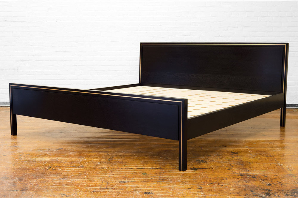 3/4 view of the Hudson Bed in ebonized walnut and brass