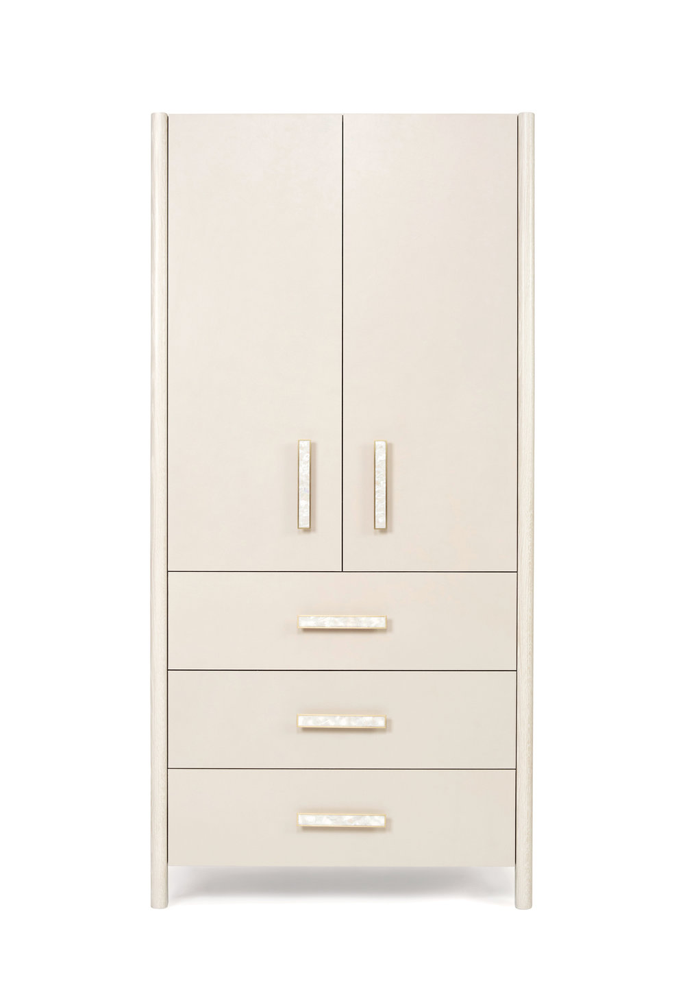 The North River armoire in bleached oak, leather doors and drawer fronts with brass pulls inlaid in mother of pearl