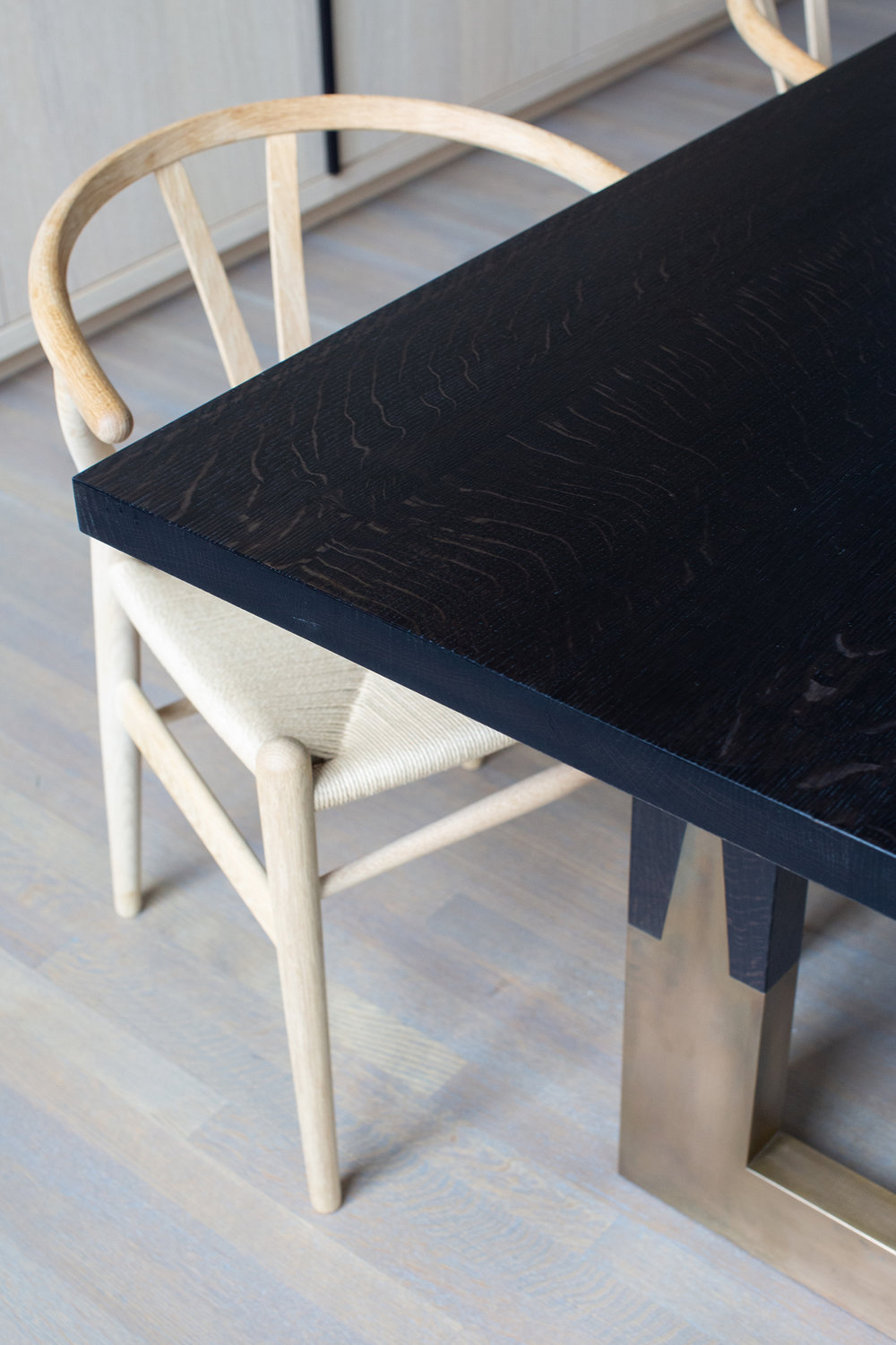Custom dining table in ebonized oak and bronze