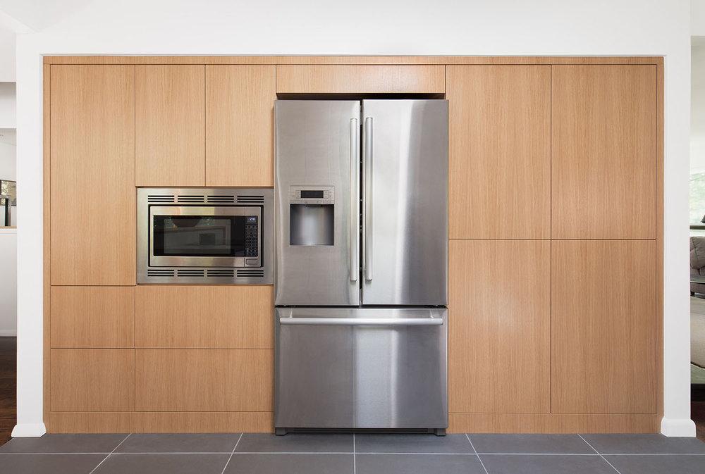 Custom white oak kitchen cabinetry push to open hardware