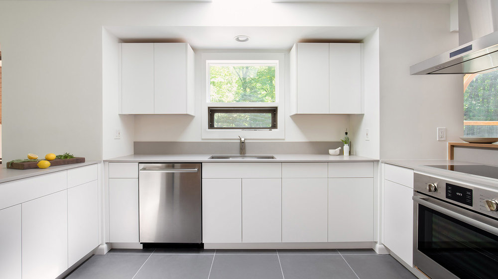 Custom painted kitchen cabinetry push to open hardware