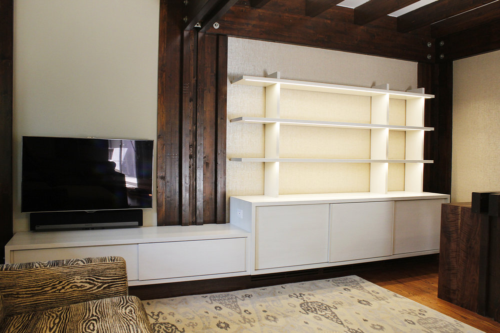 Media cabinet with sliding doors and under shelf LED lighting in bleached and white washed oak