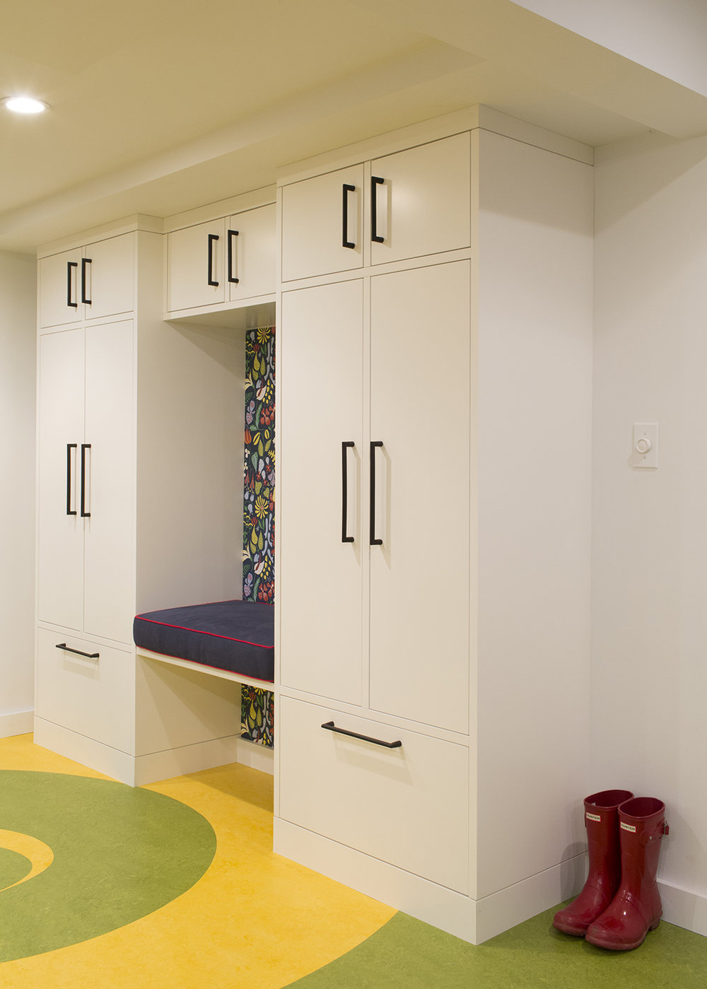 Fun and playful mudroom storage and bench
