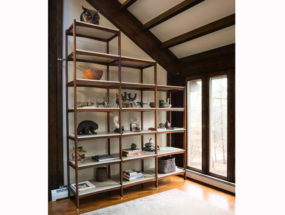 Tall etagere in solid walnut with concrete shelves