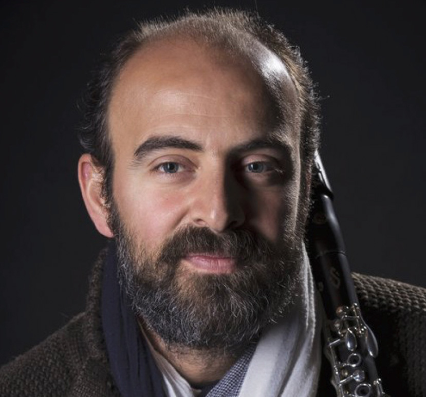 Kinan Azmeh: Clarinet, Composer   Hailed as a Virtuoso and Intensely Soulful by the New York Times and Spellbinding by the New Yorker, Kinan Azmeh is one of Syria's rising stars. Born in Damascus, Kinan was the first Arab to win the premier prize at the 1997 Nicolai Rubinstein International Competition, Moscow. A graduate of New York's Juilliard school, Kinan earned his doctorate degree in music from the CUNY in 2013. He is artistic director of the Damascus Festival Chamber Music Ensemble, and a frequent guest faculty at the Apple Hill Center for Chamber Music. Kinan is also a member of Yo-Yo Ma's Silk Road Ensemble.   kinanazmeh.com
