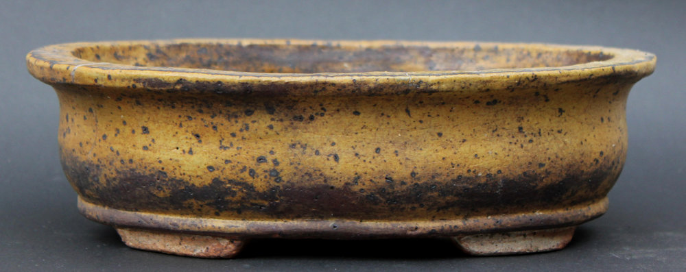 This commercial glaze turned this colour in the wood-fired kiln only once. Made in 2010.
