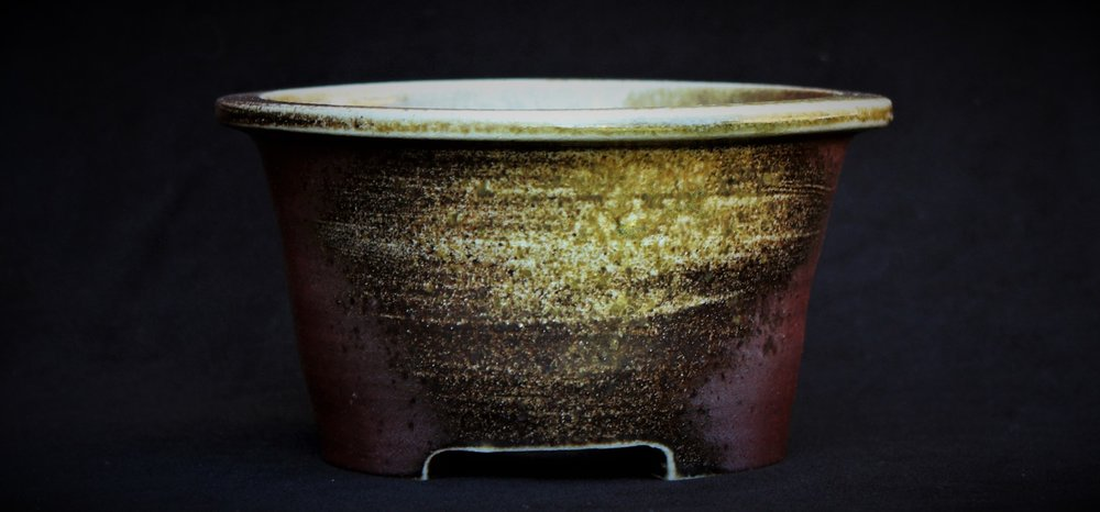 Unglazed Namban style pot with a natural ash deposit and carbon inclusion.