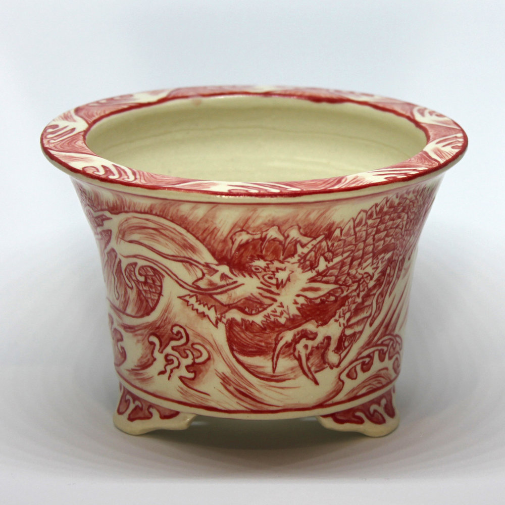 Finished pot with a clear glaze applied over the painted design and fired again to 1280°C.