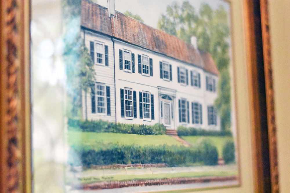 One of two paintings gifted to the Pickerings hang in the entry of their home today.