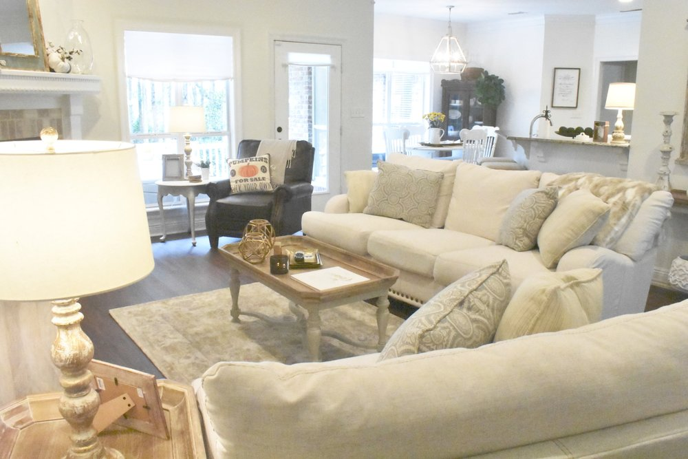 Laminate wood floor from  City Home Center , furniture from  Rubies Home Furnishings .