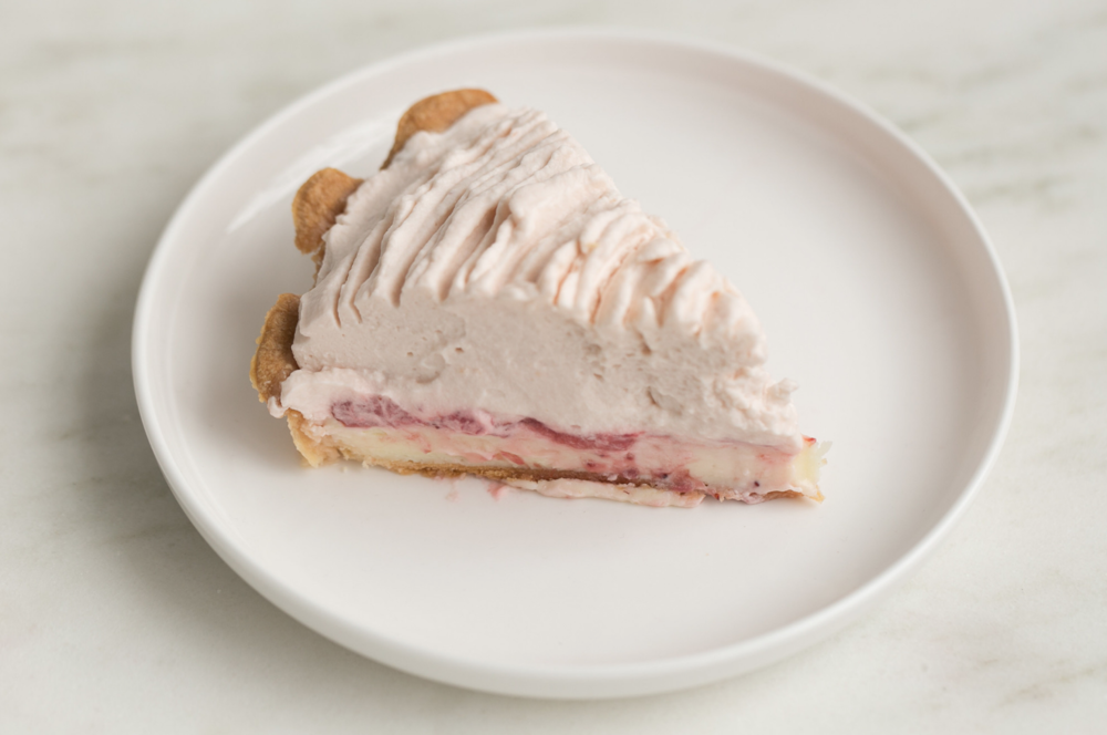 White Chocolate Strawberry - Say hello to this fluffy cloud of strawberry whipped cream with a foundation of dense white chocolate cheesecake. These delicious layers meet in the middle with a sweet spread of baked strawberries. See what Food Network was talking about when they named this pie one the Best Pies in America.