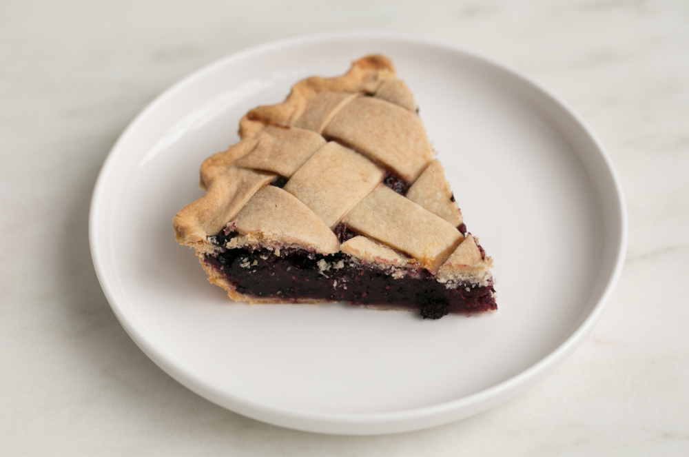 Mixed Berry - This sweet berry concoction can make the most serious city slicker crave an afternoon on a blueberry farm.  Before you indulge in this scrumptious fruit pie, don't forget to take a picture of the beautiful lattice of Peggy Jean's pie crust. Once you take a bite, you'll understand why our pie crust recipe is too darn good to share. Buy your pie now.