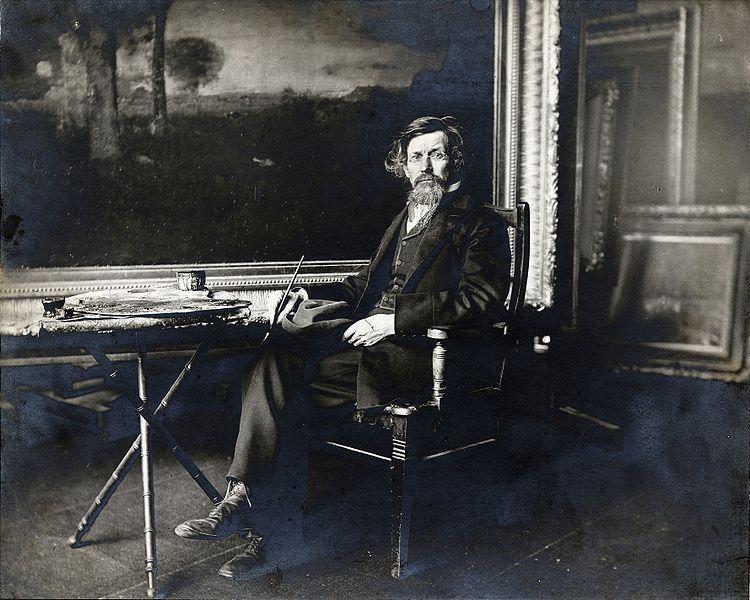 George Inness in his studio