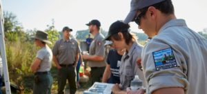 National park rangers and volunteers review planting map for National Public Lands Day