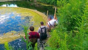 Volunteers take samples from the reservoir at Coldwater Spring