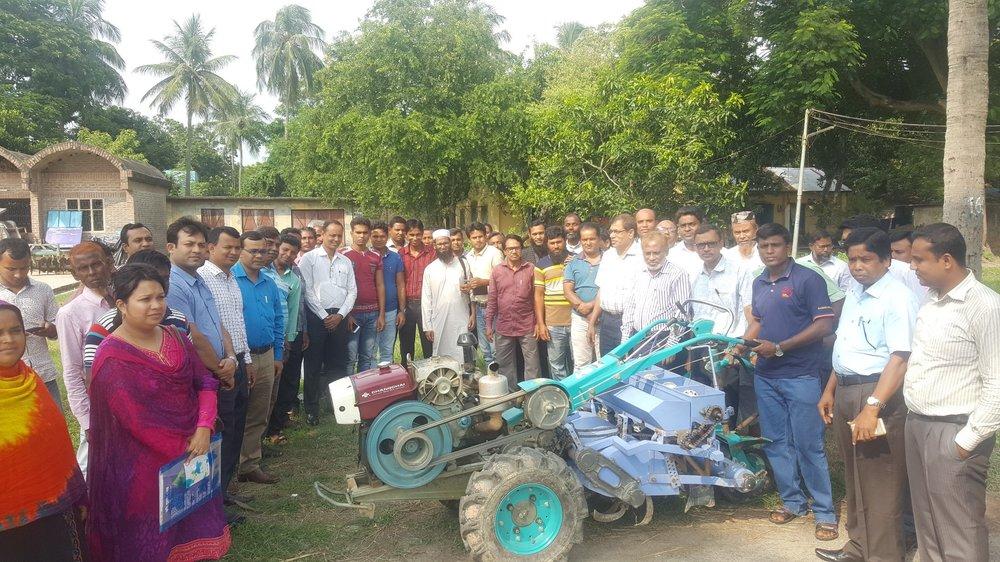 The project Inception Workshop participants visiting the Versatile Multi-crop Planters.  Photo: Dr. Md. Enamul Haque.