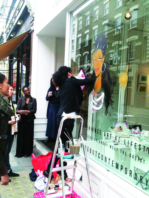 ME DOING A WINDOW PAINTING FOR DEBUT GALLERY LONDON NOTTING  HILL