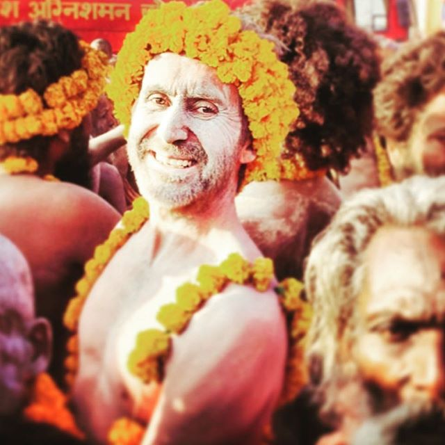 "Here he is @bruceparry.tawai smiling in the midst of the intensity of the Kumbh Mela ""Greatest Gathering"" experience. What a phenomenal experience it was. #kumbhmela #bethechange #tawai #bruceparry #india #sadhus #marigolds"