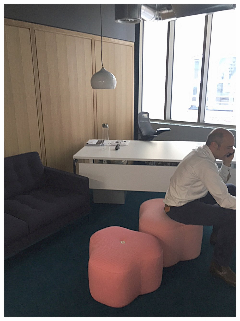 Poppy Bloom Stools in an office.
