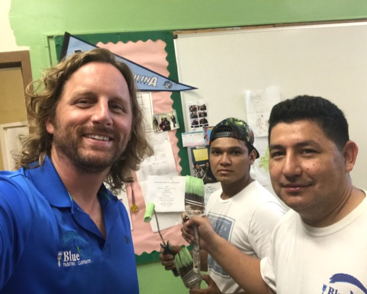 Project Manager, Adam, and some of his crew. - Everyone involved was proud to be working on this project to help liven up the school's classrooms.