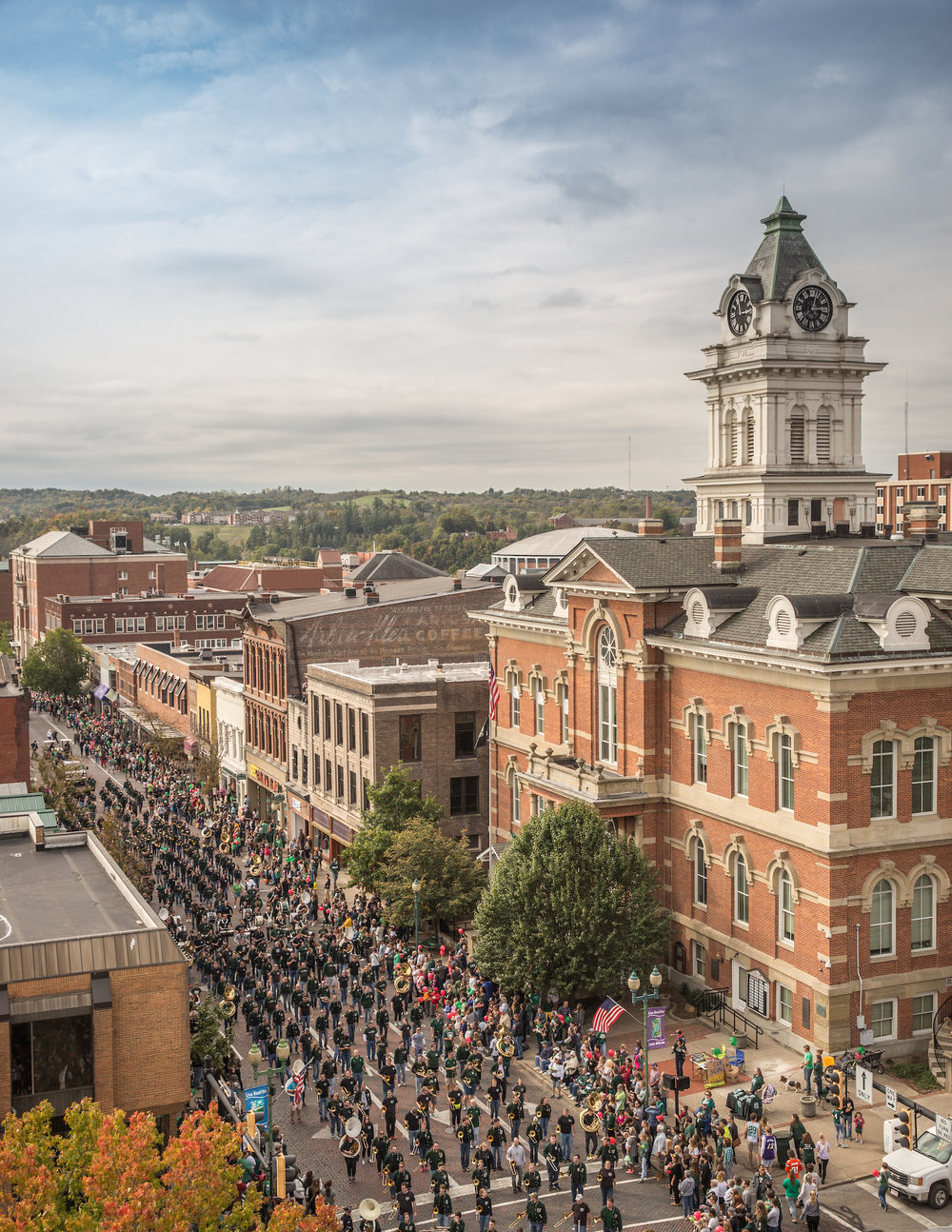 The Alumni Marching 110 proceed down Court Street in Uptown Athens, Ohio during the Ohio University Homecoming parade. [Photography courtesy of the Athens County Convention and Visitors Bureau]