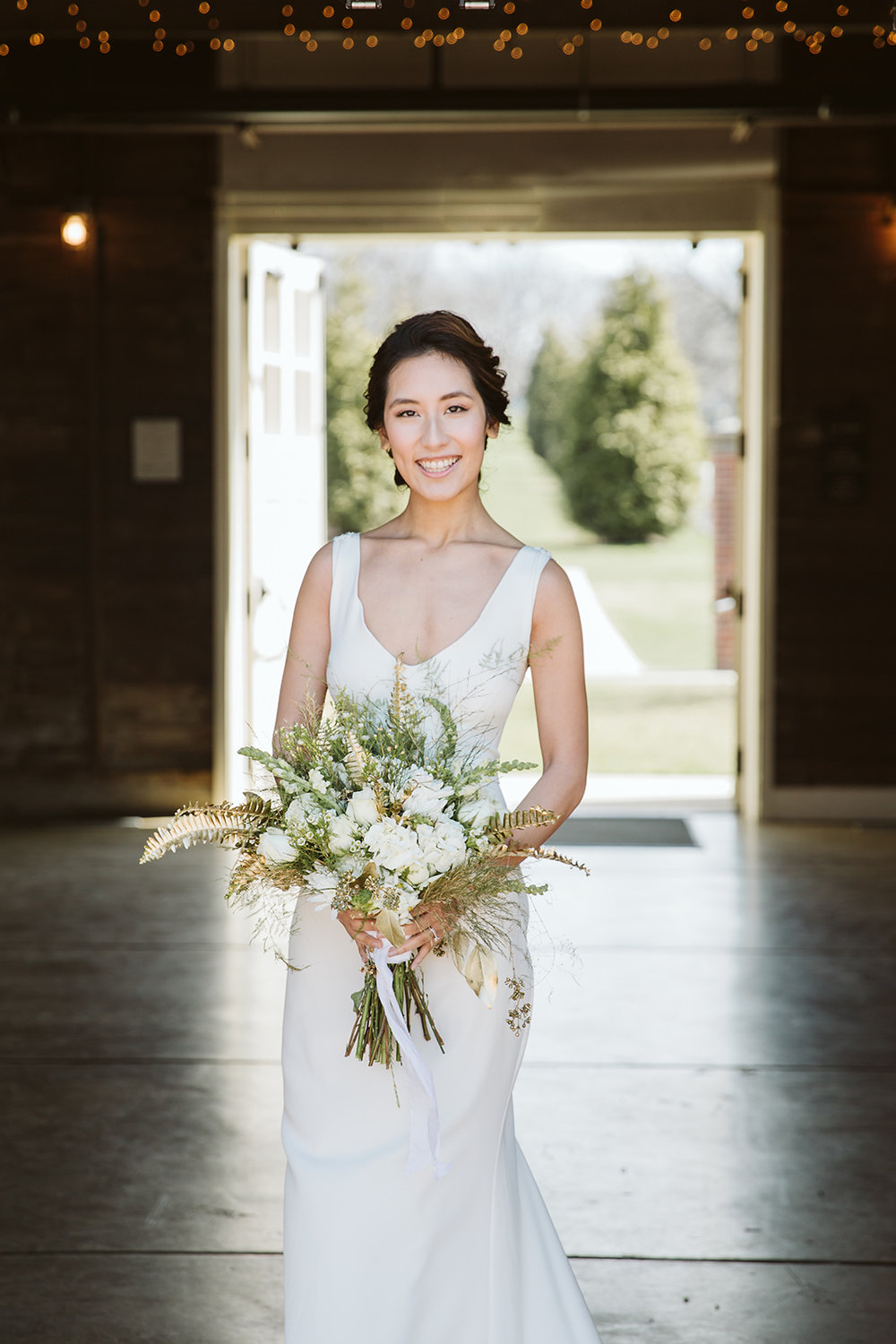 Gorgeous bride with curly updo
