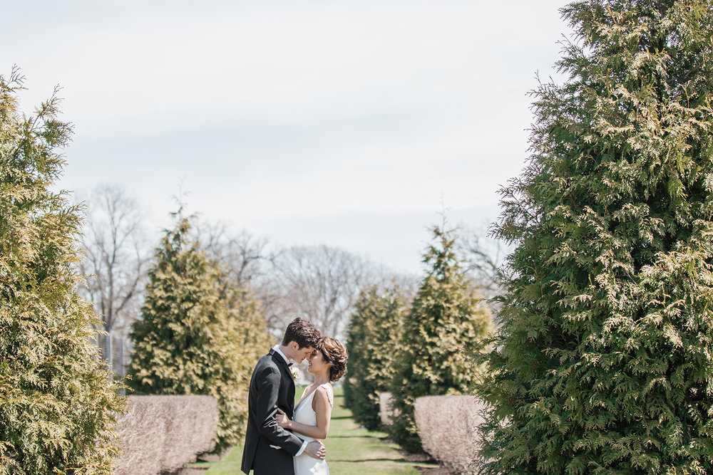 Couple shares a cute moment at Elawa Farm in Chicago for their spring wedding