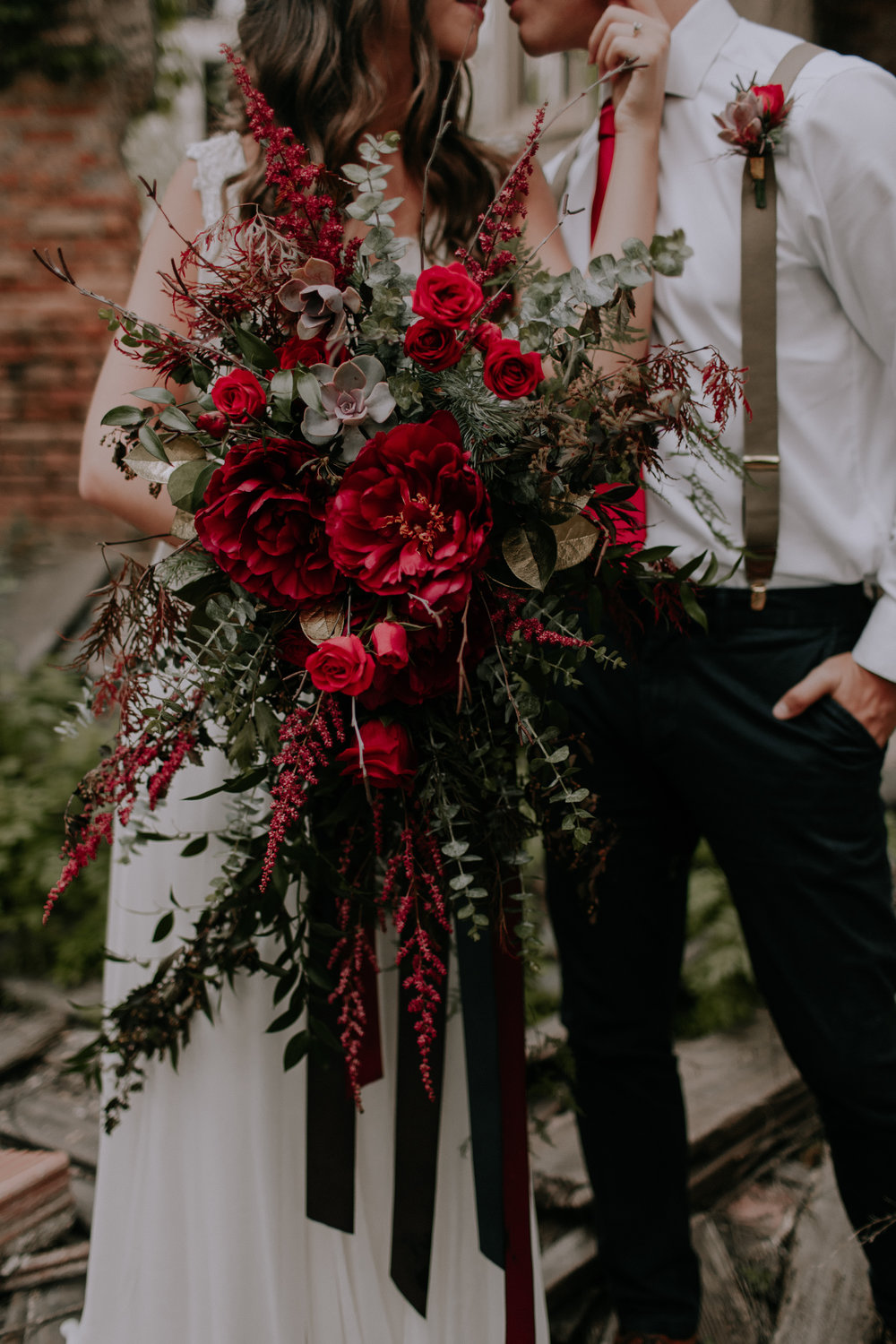 Cascading red roses bride bouquet