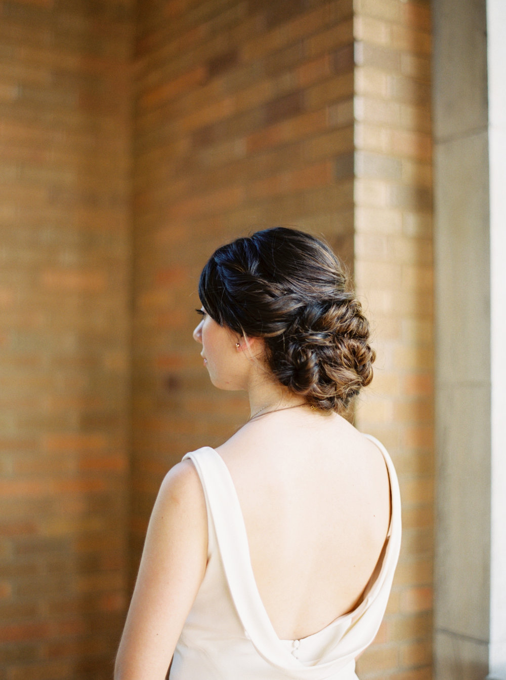 Beautiful twisted updo for outdoor wedding