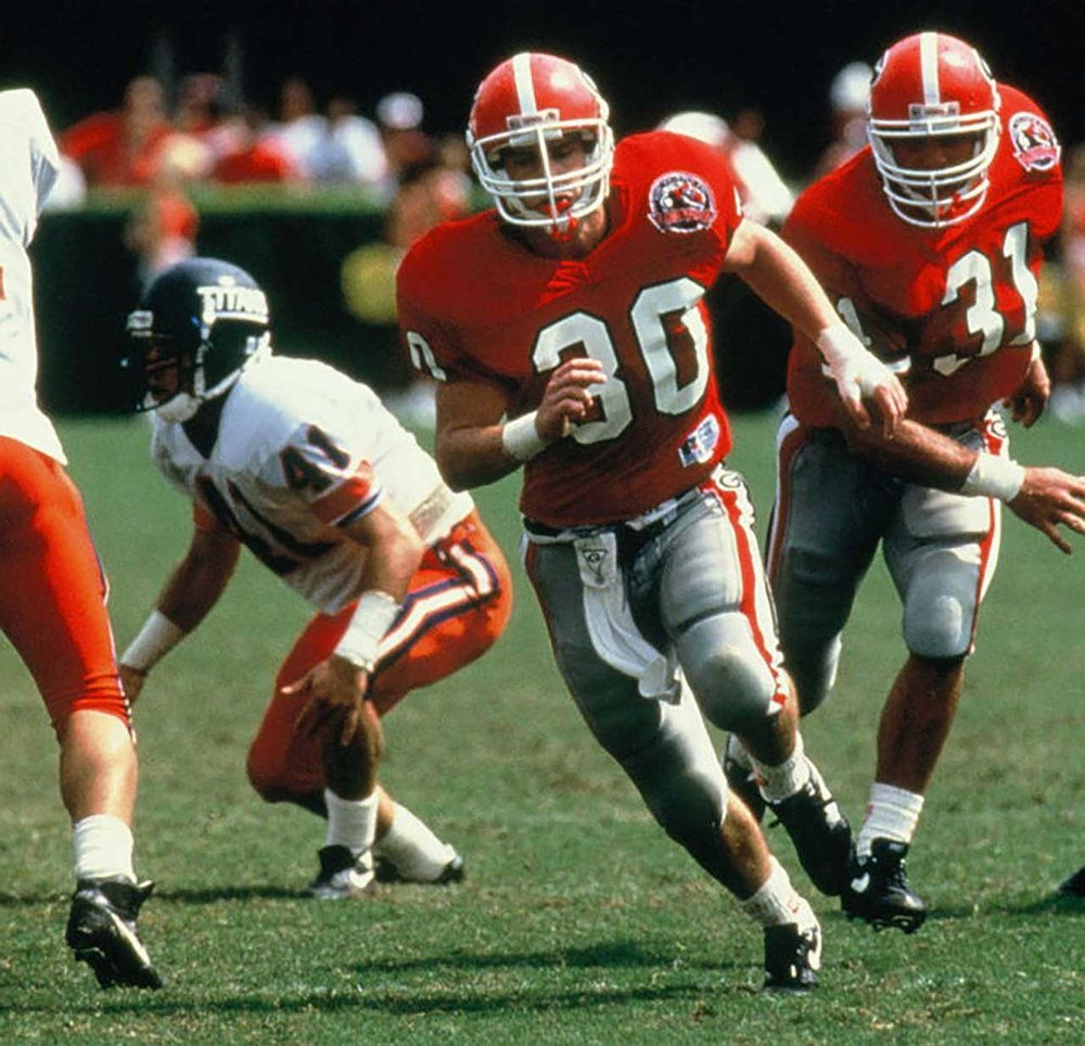 Will Muschamp (30) rushing the passer vs Cal State Fullerton in 1992 - via UGA Athletics