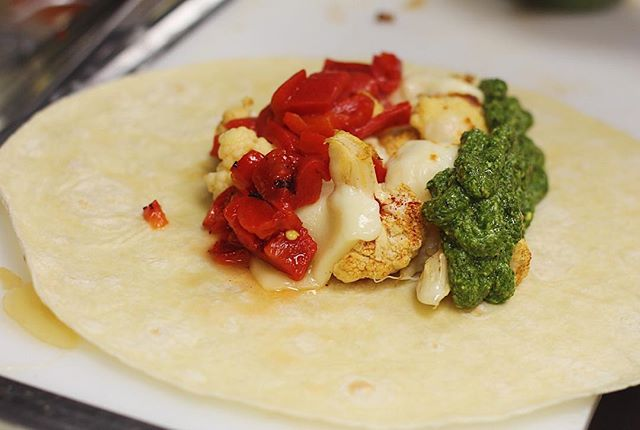 Cauliflower Wrap Comin in hottt🔥 Roasted cauliflower, roasted red peppers, provolone, macho pesto on a wrap! Come n get it.