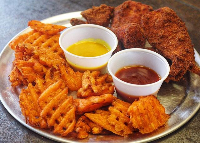 Our version of #chickenandwaffles is 🔥Sweet potato waffle fries with our crispy chicken tenders and two sauces . Honey mustard or BBQ? Comment below which sauce you prefer! #twoisbetterthanone ‼️