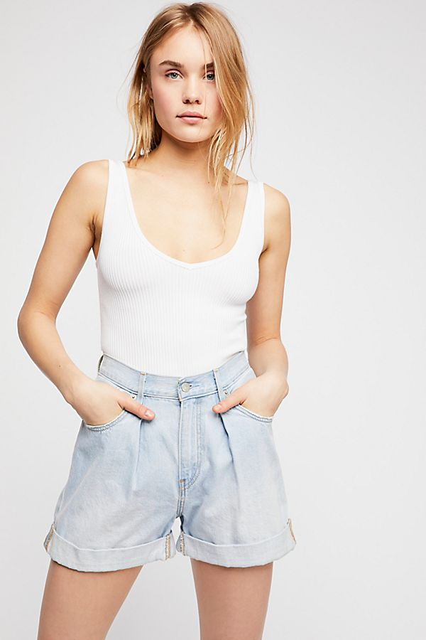 These are Levis and I love the pleat front details and the loose leg.