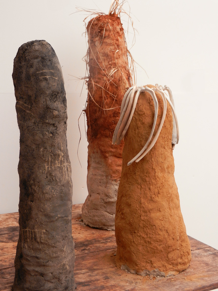 Three Earth Figures Clay and found materials, max height 76 cm 2014