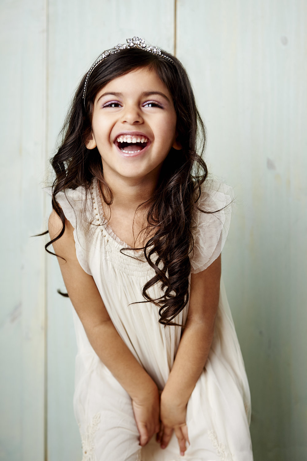 Marta-Hewson-Classical-portrait-young-girl-tiara-laughing.jpg