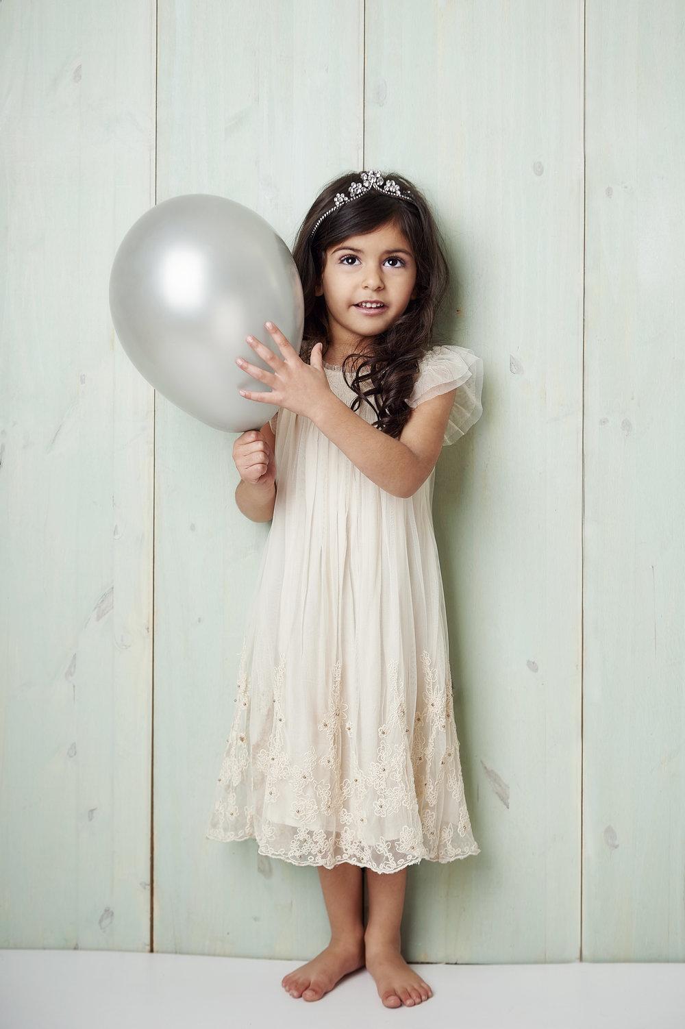 Marta-Hewson-Classical-portrait-young-girl-tiara-silver-baloon.jpg