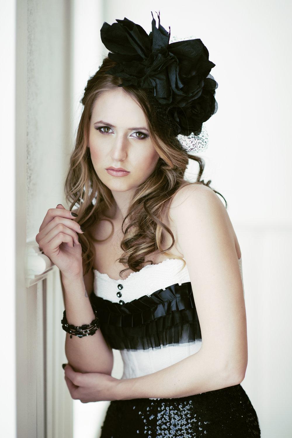 Marta-Hewson-Themed-portrait-Kristina-Jovanovic-resting-against-wall.jpg