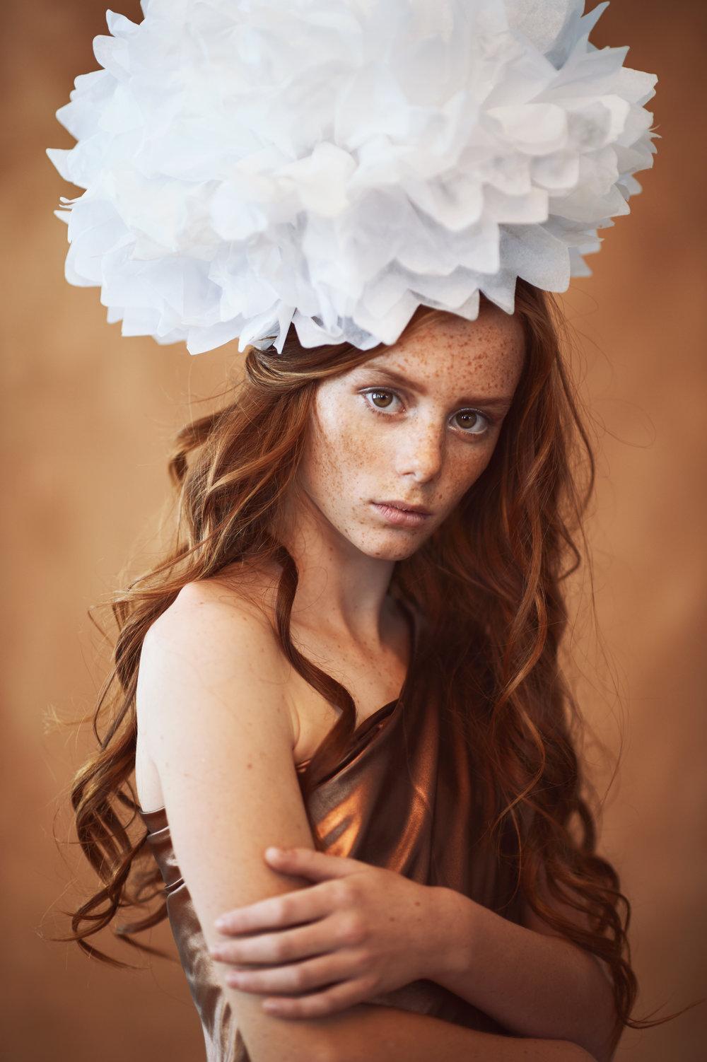 Marta-Hewson-Themed-portrait-red-head-freckles-paper-flower.jpg