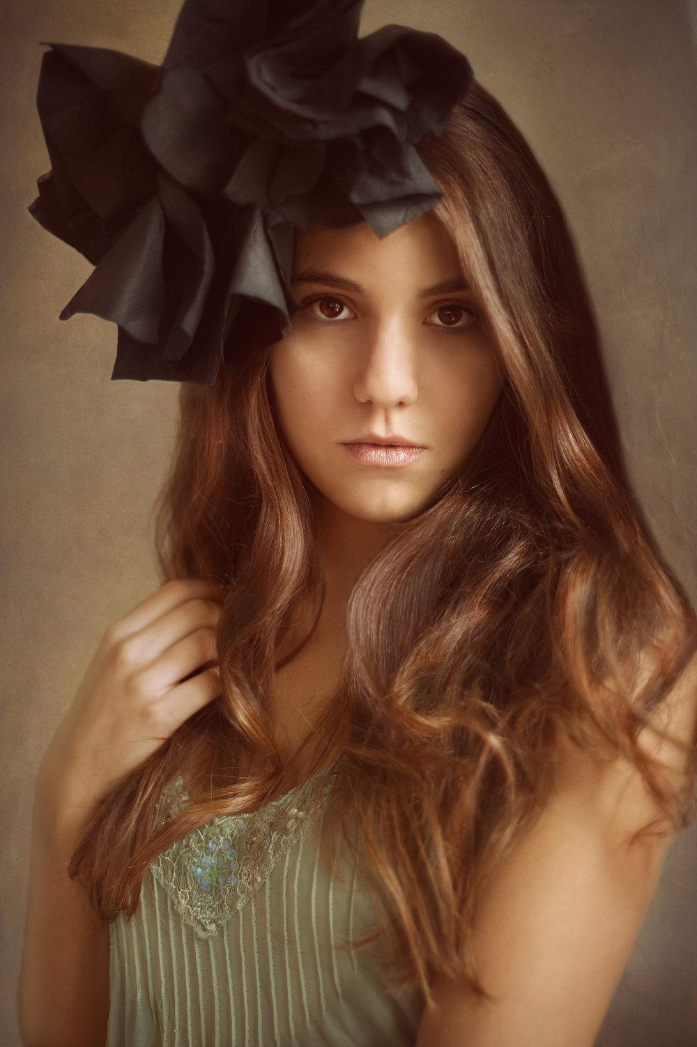Marta-Hewson-Themed-portrait-young-women-with-black-flower-in-hair.jpg