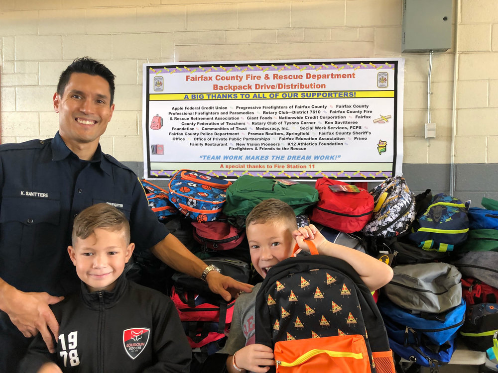 (Left to Right) Ken, Maks and Madden Savittiere at the Backpack Drive Aug. 2018