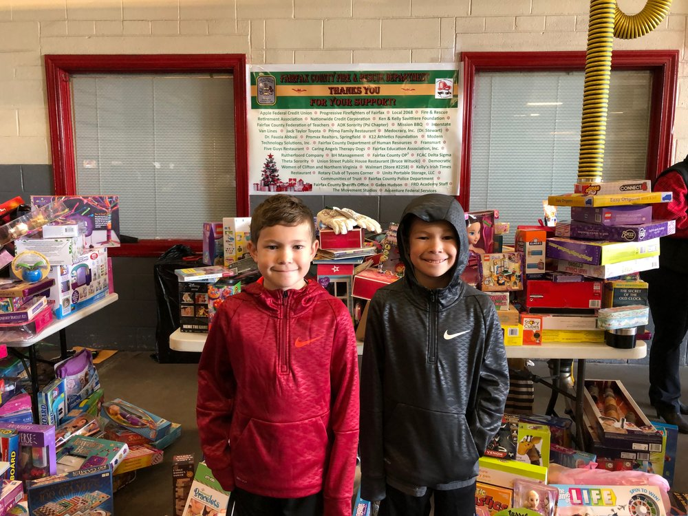 (Left to Right) Maks and Madden at the Toy Drive Dec. 2018 after another job well done