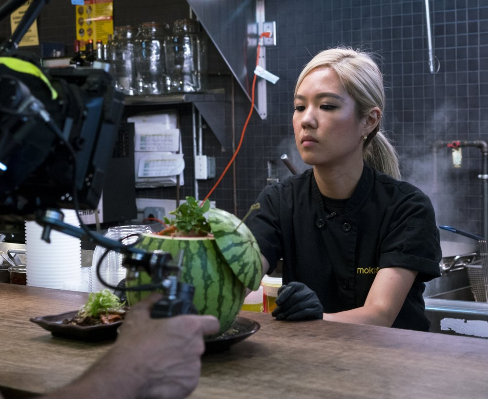 Esther Choi - Esther Choi is a chef and restaurateur whose heart beats for the Korean food she grew up cooking with her beloved family. Classically trained and a product of the NYC restaurant world, Esther's beginnings in the culinary industry go back to when she was fourteen years old. Now, after working in kitchens around the city (including a full-time stint at Food Network), she runs three Korean restaurants: Mokbar, both the original Chelsea Market stall plus one in Brooklyn, and Ms Yoo, an event space on the Lower East Side. Join us as we hear more about Esther's story and how her tenacity, her faith, and her family kept her focused on growing a career and restaurant portfolio.
