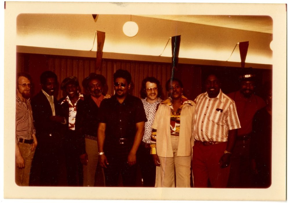 Group shot from the 1975 Miami Blues Festival (l-r): John Fishel, Buddy Guy, Junior Wells, Robert Jr. Lockwood, Eddie Baccus, Jim Fishel, Mable Hillery, Johnny Shines, Son Seals, Koko Taylor (cut off) [courtesy of Jim Fishel]