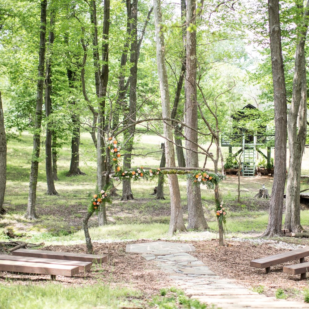 The Woodland - If you are looking for that one of a kind woodland ceremony location, look no further! We know that finding a woodland setting is hard to find in this area. We have custom designed a woodland arch that is ready to be decorated to your hearts content. Guests may even witness a passing deer or two!Photo courtesy of Jalapeno Photography
