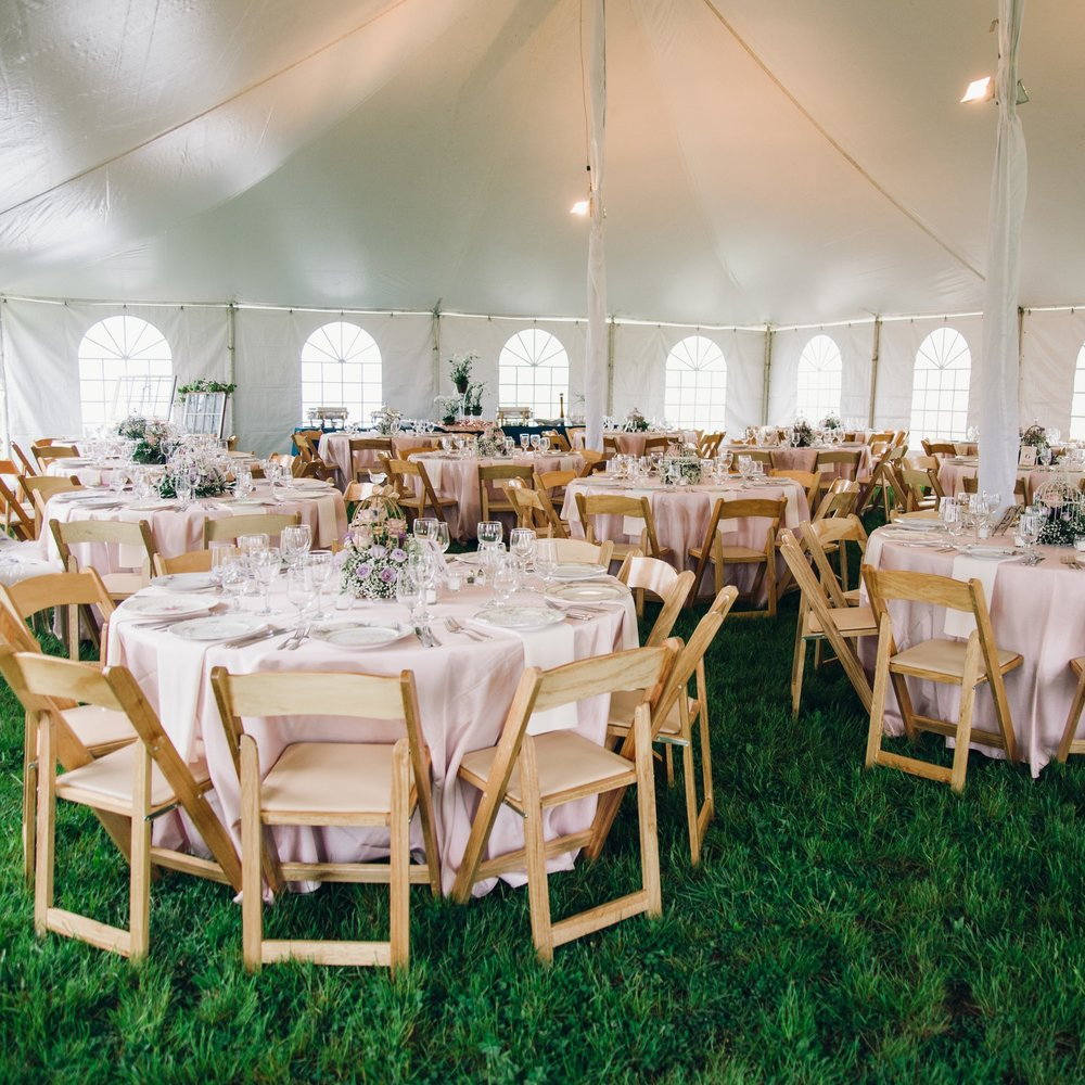 Tents - Tents and other temporary structures are placed near the barn on land that has been graded to accommodate the largest of tents. This works particularly well for large weddings that also want to use the barn for the night time festivities.Photo courtesy of Photography Du Jour