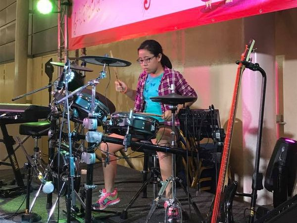 Girl with drums_cr_600x450.jpg