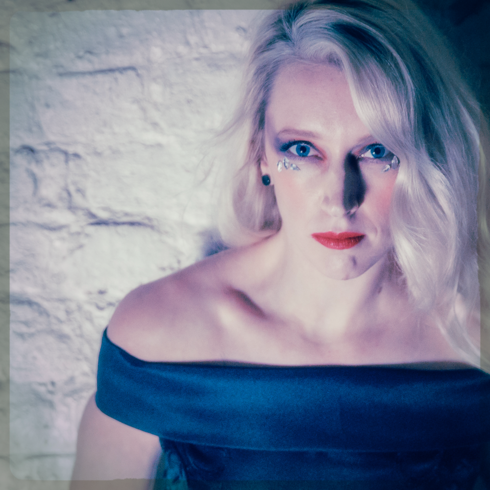 VOCALS // SARAH - Sarah moved to New York at 21 to study acting and fell in love with the city. She discovered a new passion - music! Finding inspiration in artists such as Madonna, Blondie,Bowie and No Doubt, Sarah knew from that point on she would focus on singing.